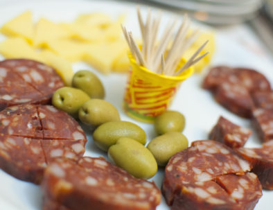 Italian salami with olives and herbs